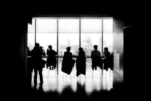 Men in corporate building, Perth Western Australia. Asking what are managed services in the IT industry.
