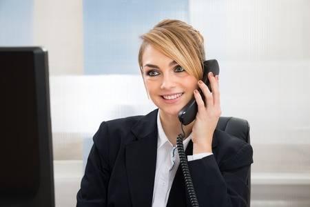 Lady using IP Phone